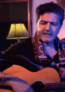 Arieb Azhar holding guitar