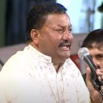 Pyarelal Wadali singing in with a hand on mic