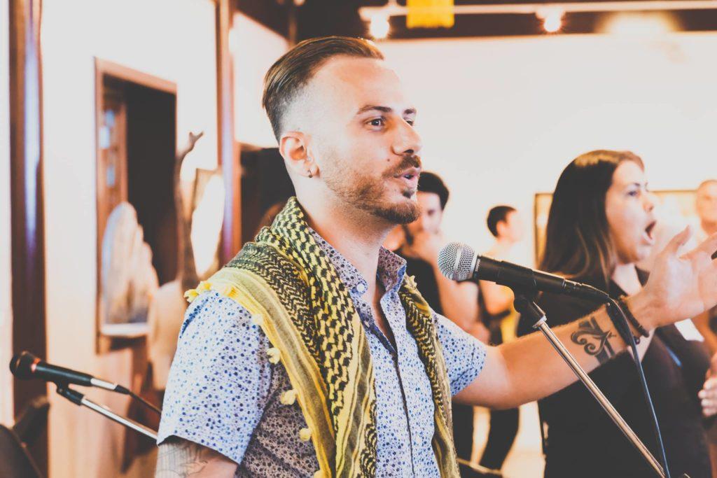 Muslim man singing music in front of mic